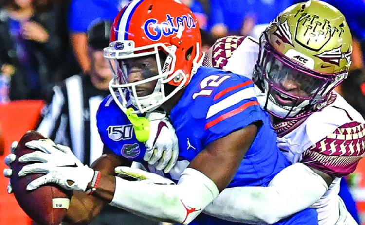 Florida's Van Jefferson crosses over the goal line with the ball for a touchdown Saturday night against Florida State. (JOHN STUDWELL / Special To The Daily News)