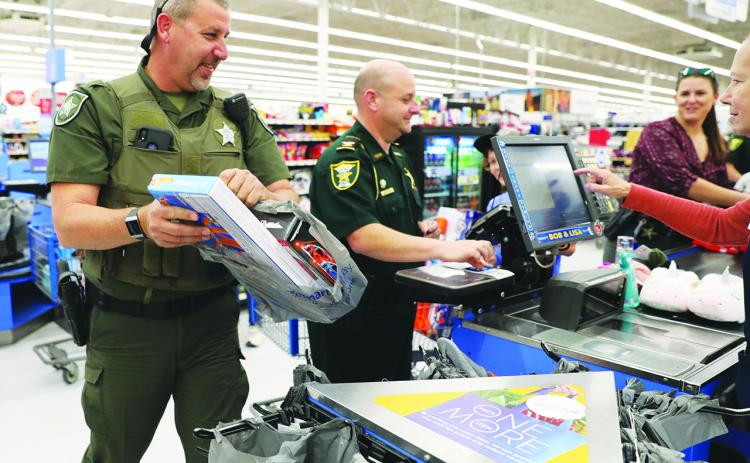 Law enforcement officers take local children on a shopping spree for Christmas.