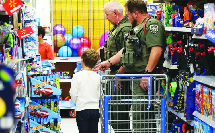 Deputies take local children on a shopping spree before Christmas.