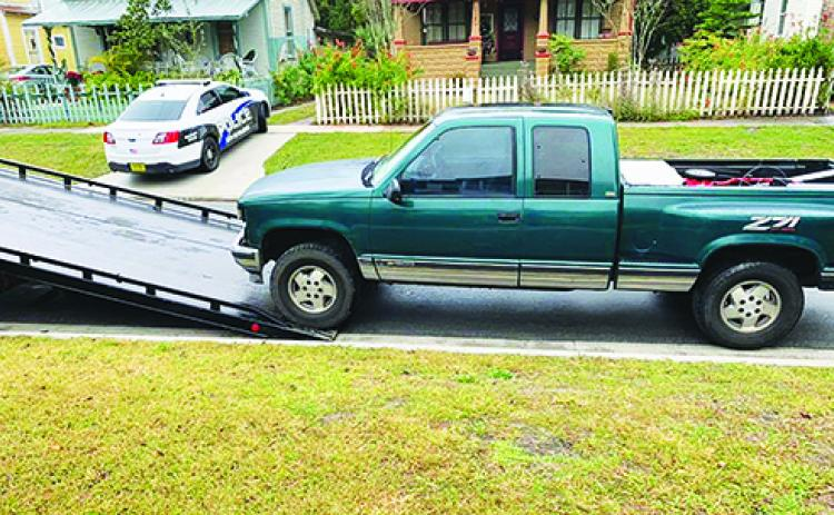 Police have a truck suspected to have been used in a car wash theft towed as evidence.