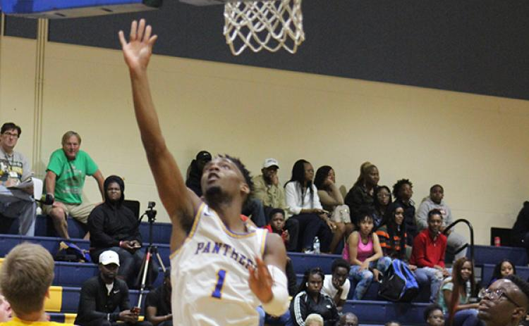 Palatka's DeShawn Shaw (1) scores during Thursday night's opener against Longwood Lyman High in the Jarvis Williams Christmas Tournament. (ANDY HALL / Palatka Daily News)