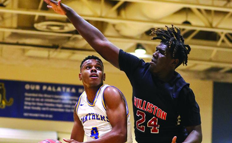 Palatka's Jimmy Williams, left, goes against Williston's Kamarious Gates during the first half of Friday's semifinal. (GREG OYSTER / Special To The Daily News)
