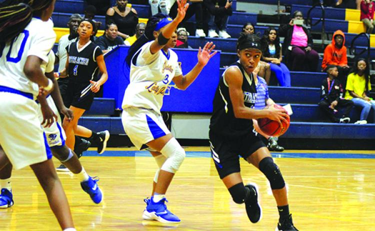 Interlachen's Malea Brown drives to the basket against Palatka's Diovoinne Fells. (MARK BLUMENTHAL / Palatka Daily News)