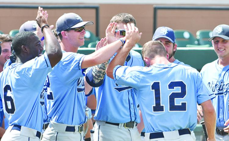 St. Johns River State College baseball player Myles Straw (12) is congratulated by teammates after scoring a run in the Vikings' 16-9 17-inning victory over Gulf Coast State in the 2015 FCSAA/NJCAA Region 8 baseball tournament at Joker Marchant Stadium in Lakeland. (File photo)