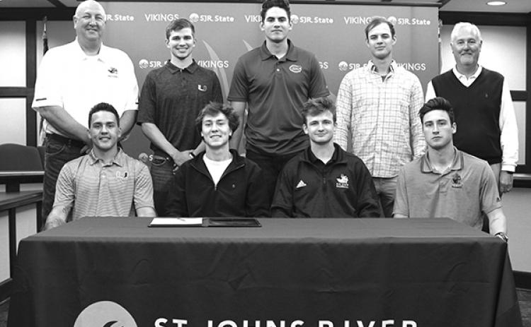 SJR State Athletic Director and head baseball coach Ross Jones and SJR State President Joe Pickens stand with Viking baseball players who recently signed national letters of intent to continue their baseball careers at the university level. First row, from left:  Michael Rosario, Stephen Halstead, August Haymaker and Nick Tripp. Second row from left, Jones, Jordan Dubberly, Franco Aleman, Jackson Spiller and Pickens. (Photo courtesy of SJR State)