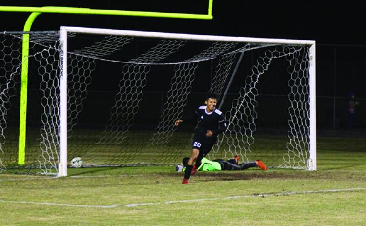 Crescent City's Ivan Camacho runs away from the goal happy after teammate Calletano Santana scored his team's third goal of the game early in the second half. In the background on the ground is Palatka goalkeeper Dalton White. (MARK BLUMENTHAL / Palatka Daily News)
