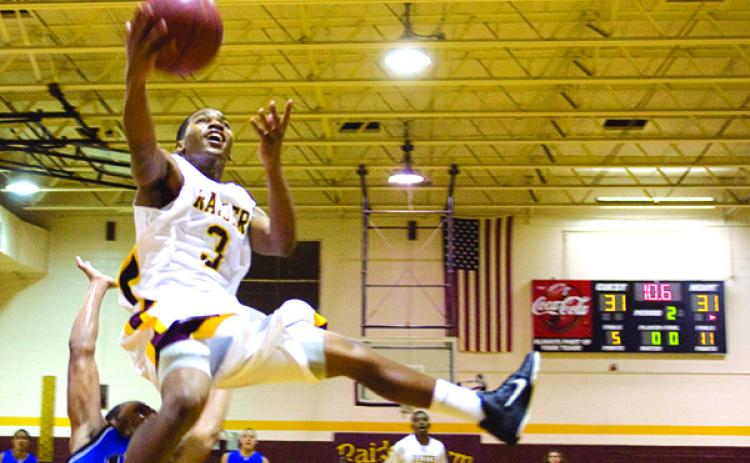 Crescent City's Jerrell Oxendine drives to the basket near the end of the first half of the game against Interlachen on Jan. 14, 2011. (Daily News file photo)