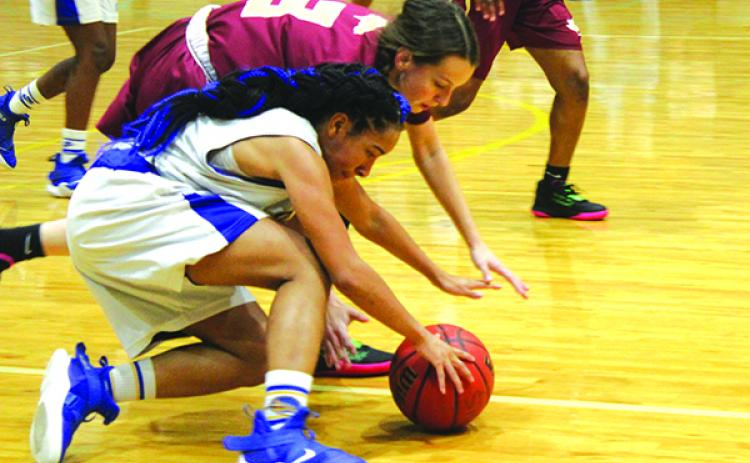 Palatka's Kavayshia McCormick battles North Marion's Brooke McConne (3) for the basketball. (ANDY HALL / Palatka Daily News)