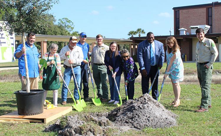 City of Palatka officials and other community leaders mark Arbor Day with preparations to plant a live oak tree at SJR.