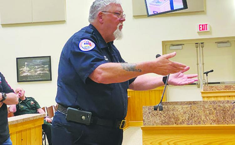 Former Putnam County firefighter John Chapman addresses the Board of County Commissioners at Tuesday's workshop to discuss conditions local emergency workers face.