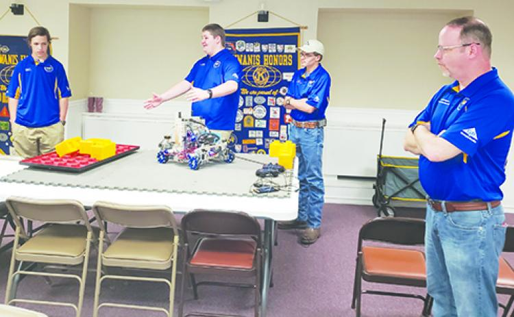 Palatka High School robotics team members Colby Brooks, Micah Hall and Kacen Byrd talk about their robot during a demonstration for the Kiwanis Club of the Azalea City as coach Rob Knutsen looks on.