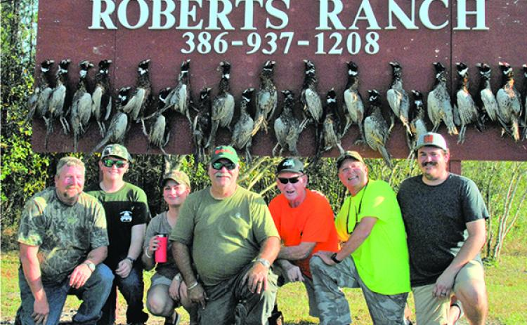 From left, hunters Terry French, Kaleb Hall, Staci Johns, George Johns, Tommy Baker, Mike Reynolds, Hunter Winkleman. (GREG WALKER / Special To The Daily News)