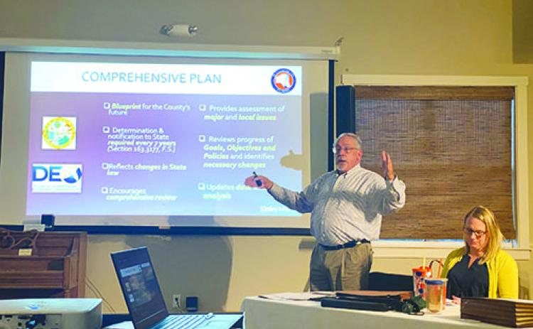 Planning coordinator Brian Teeple explains Putnam County's comprehensive plan Thursday night to Melrose residents.
