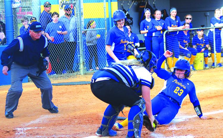 Palatka's Samantha Clark slides home in the third ahead of the tag by Interlachen catcher Dixie Smith. (MARK BLUMENTHAL / Palatka Daily News)