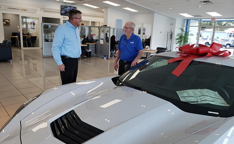 Sales consultant Bill Gaines, right, talks with Jeremy Alexander, general sales manager at Beck Chevrolet in Palatka. Now 81, Gaines has spent 50 years in the automotive industry.
