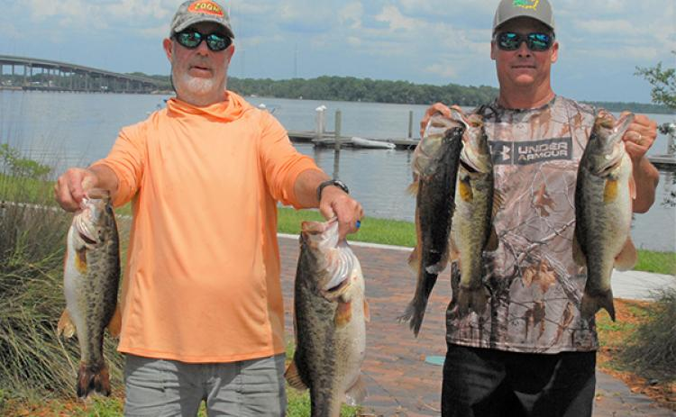Frank Streeter, left, and Brian Sousa hold up their winning catches on Saturday near the Palatka City Dock. (GREG WALKER / Special To The Daily News)