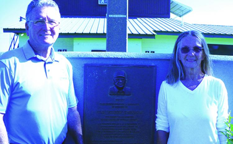 John Raymond Theobold and his sister, Marian Ryan, stand in front of the plaque honoring their father, John Theobold, whose name graces the John Theobold Sports Complex (MARK BLUMENTHAL / Palatka Daily News)