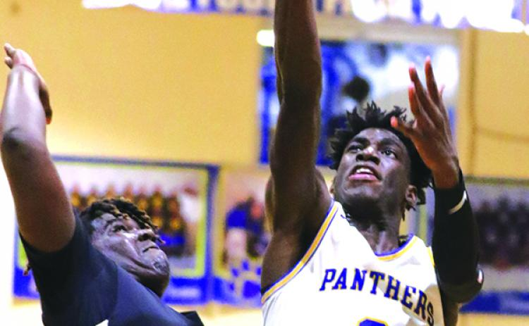 Palatka's Malik Beauford goes up for a layup against Williston's Kamarious Gates during last December's Jarvis Williams Christmas Tournament at Palatka High School. (GREG OYSTER / Special To The Daily News)
