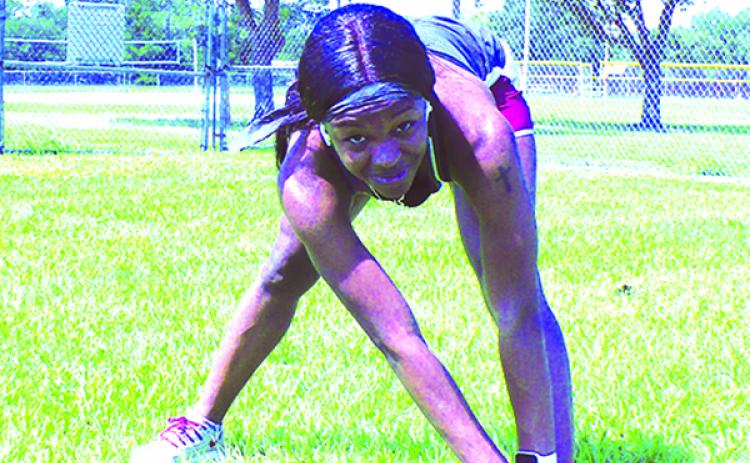 Florida State track star Ka'Tia Seymour stretches her muscles as she sets to work out last week. (MARK BLUMENTHAL / Palatka Daily News)