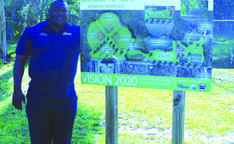"Palatka Mayor Terrill Hill shows off the Vision 2020 plan for the John Henry ""Pop"" Lloyd Sports Complex, set to open up by next year, according to Hill. (MARK BLUMENTHAL / Palatka Daily News)"
