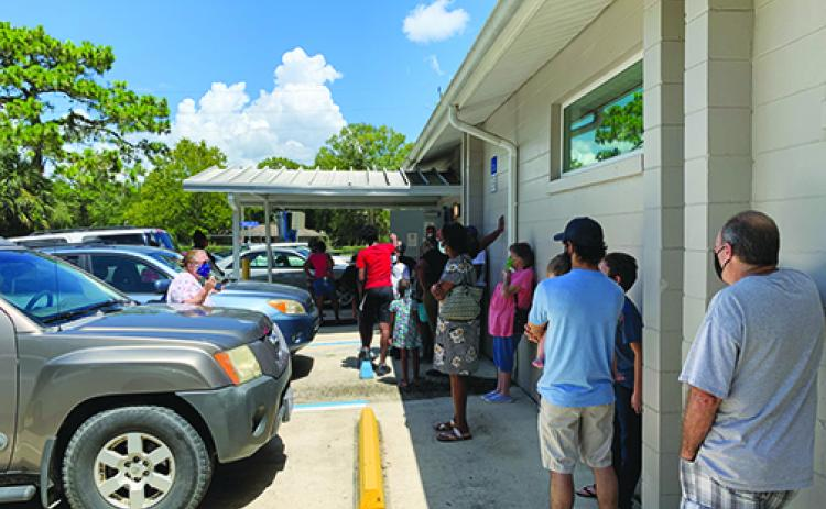 Residents line up for COVID-19 testing outside the Interlachen Community Center last week.