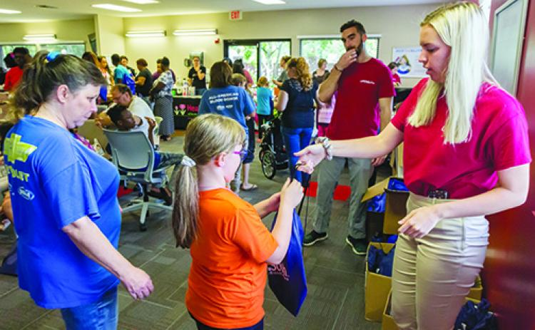 The LifeSouth Community Blood Centers backpack giveaway in 2019 was a festive event with officials handing out school supplies to local students. This year's event, however, will be drive-thru only.