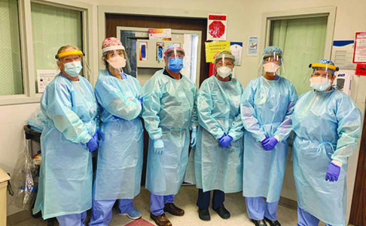 Dr. Richard Feibelman, third from left, a critical care doctor at Putnam Community Medical Center, and the hospital intensive care unit team wear their protective gear when working with COVID-19 patients.