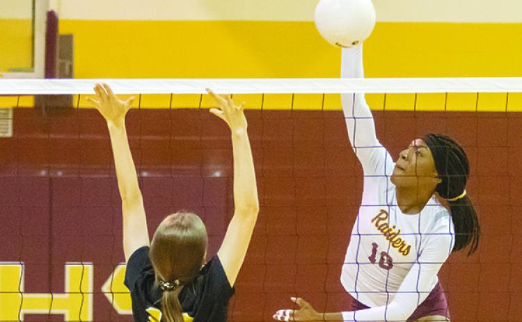 Crescent City High School's Aniya Hardy delivers the kill attempt in last fall's District 8-1A volleyball championship at home against Fort Meade. (Daily News file photo)