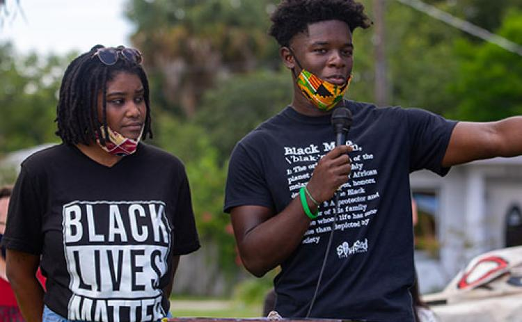 Protest organizers Dar'Nesha Leonard and Tevel Adams remind supporters Saturday why they are advocating for the removal of the Confederate monument from the grounds of the Putnam County Courthouse..