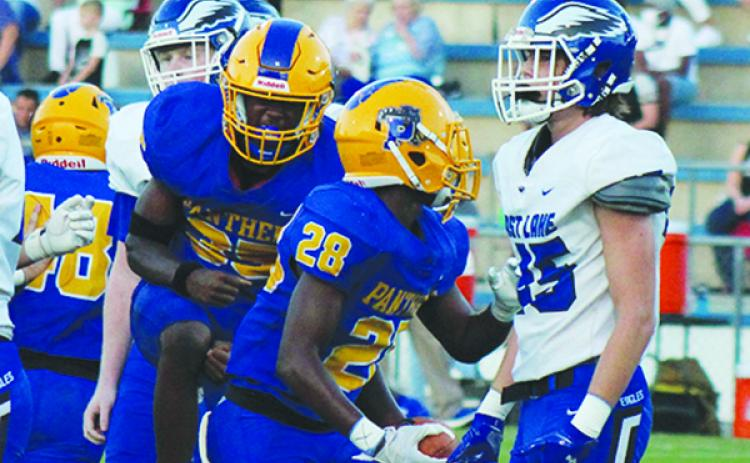 Palatka High's Kriston Mack (28) celebrates a first-quarter fumble recovery Friday night at home against Tarpon Springs East Lake High. (ANDY HALL / Palatka Daily News)
