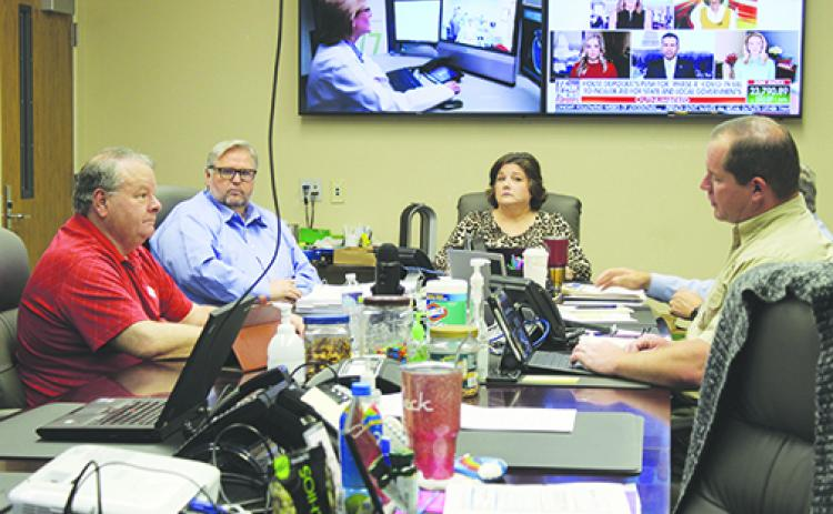 Kena Foster, center, works with Putnam County officials in April at the Emergency Operations Center in Palatka.