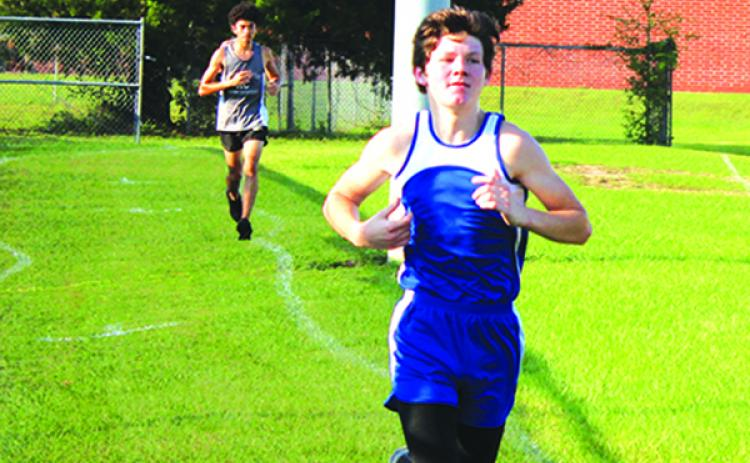 Peniel Baptist Academy's Caleb Baker, on his way to winning the All-Putnam County cross country championship on Oct. 13, will compete in the state middle school championship in Lakeland. (MARK BLUMENTHAL / Palatka Daily News)