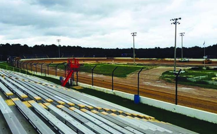 A view from the grandstands as trucks spread new clay recently at the Putnam County Speedway, which is under new ownership.
