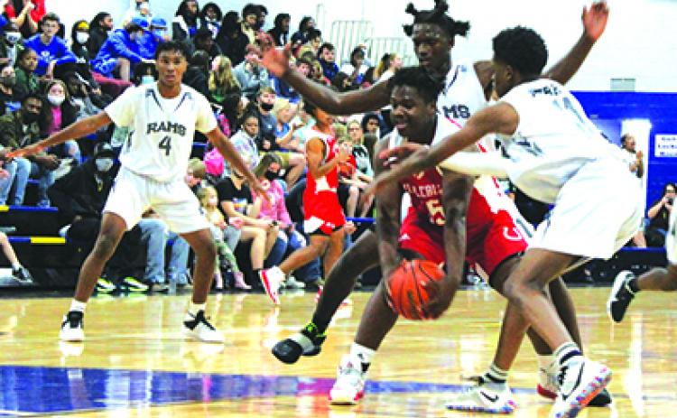 Middleburg's Donovan Wimberly is surrounded by Interlachen's Justin Herring (behind him) and Jaden Perry during Monday night's opener at Interlachen High School. (MARK BLUMENTHAL / Palatka Daily News)