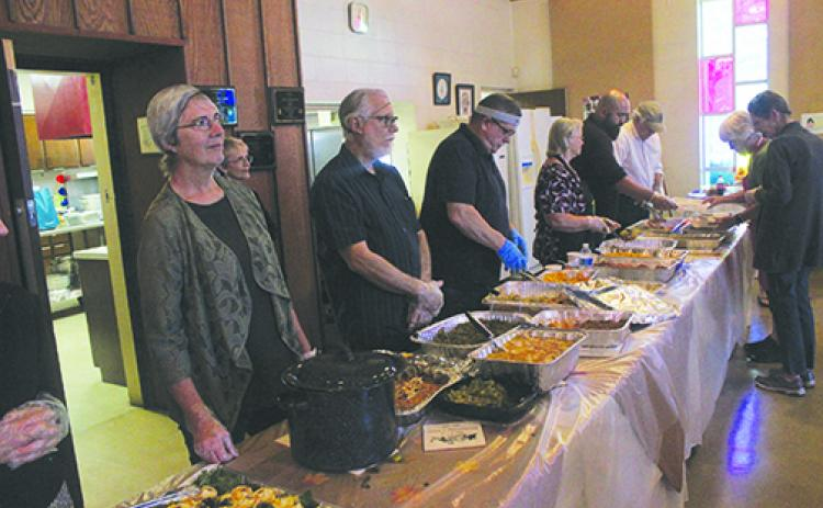 Bread of Life volunteers prepare to serve Thanksgiving last year at the church.