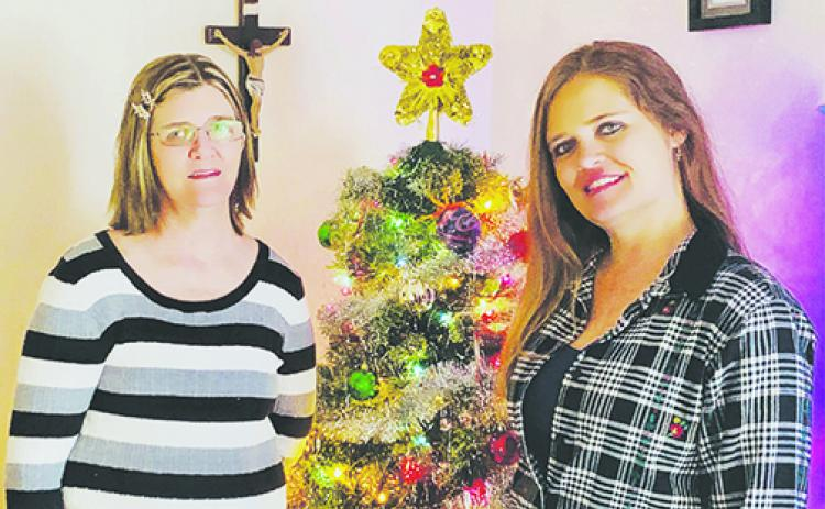Heather Betliskey, right, stands next to her mother, Carol Cunningham, by their Christmas tree 31 years after Heather received a heart transplant at the age of 2.