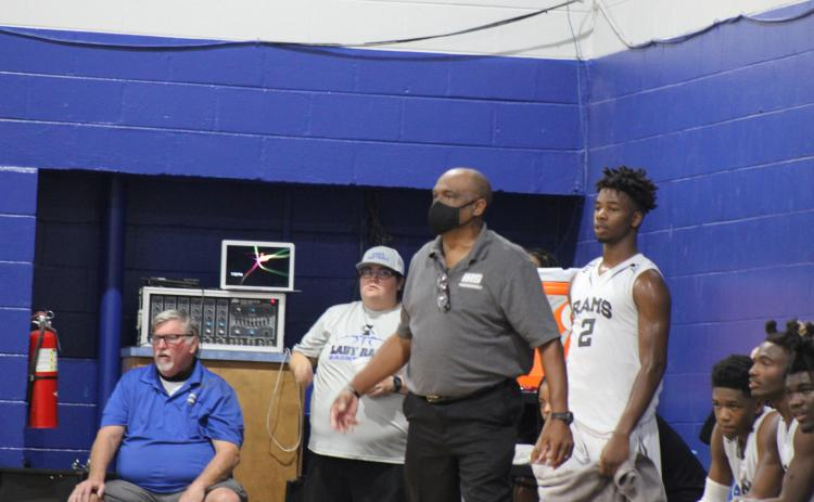 Interlachen head coach C.S. Belton stands next to player Der'Tavious Mack during the Rams' opening game of the season against Middleburg. (MARK BLUMENTHAL / Palatka Daily News)