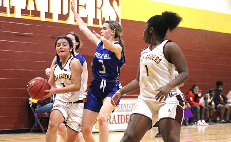Crescent City High School's Cirabella Williams, left, looks to get to the basket with Peniel Baptist Academy's Alexis Wallace defending her Thursday night. At right is Crescent City's Naudia Wright. (MARK BLUMENTHAL / Palatka Daily News)