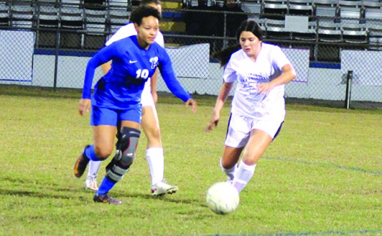 Palatka's Natasha Mullen (left) chases after the ball against Crescent City's Lili Escobedo during Wednesday night's game won by Palatka. (MARK BLUMENTHAL / Palatka Daily News)