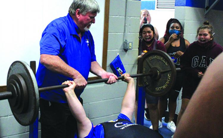 With head coach Ron Whitehurst grabbing the bar to put it back, Interlachen High weightlifter Marissa McKibben completes her 200-pound bench press in the unlimited weight class on Wednesday. (MARK BLUMENTHAL / Palatka Daily News)