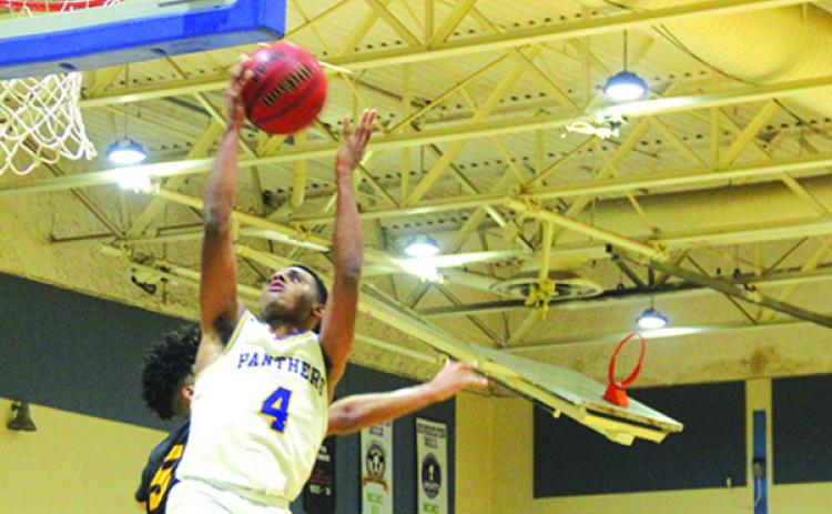 Palatka's Jimmy Williams goes up for a shot against West Nassau's Simeon Womock during Friday night's game won by the visiting Warriors, 71-62. (MARK BLUMENTHAL / Palatka Daily News)