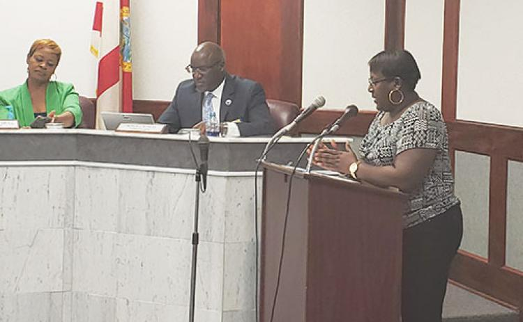 Outgoing Human Resources Director Debra Robinson, right, speaks during a 2019 Palatka City Commission meeting.