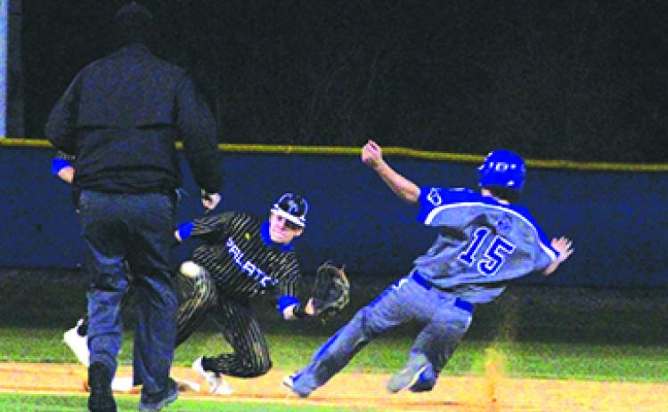 Interlachen's Brock Foshee slides safely into second base as Palatka's Seth Waltimyer takes the throw during Friday night's championship game. (ANTHONY RICHARDS / Palatka Daily News)