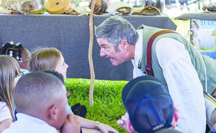 Mike Adams portrays William Bartram as he entertains children during the 2019 Bartram Frolic in Palatka. The event was canceled in 2020 because of COVID-19, but organizers are hoping to hold the event in April this year.