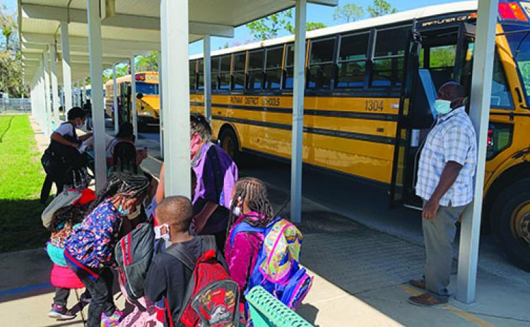 Mellon Elementary School students board buses after school concluded Thursday. Mellon is slated to close at the end of the 2020-2021 school year.